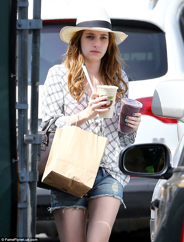Keeping cool: The actress clutched two iced drinks to ensure she stayed cool and hydrated in the city