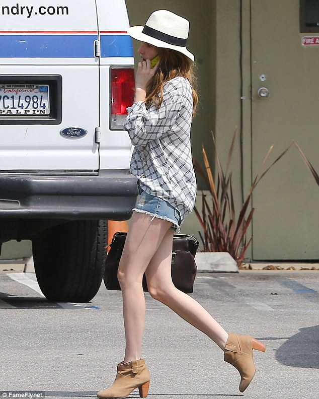 Get your pins out: The 22-year-old flashed her alabaster legs in a pair of tiny distressed denim hotpants