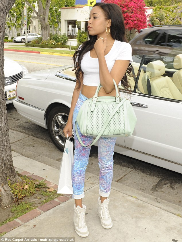 Just seventeen: Dionne showed her taunt stomach and long legs in her on-trend outfit