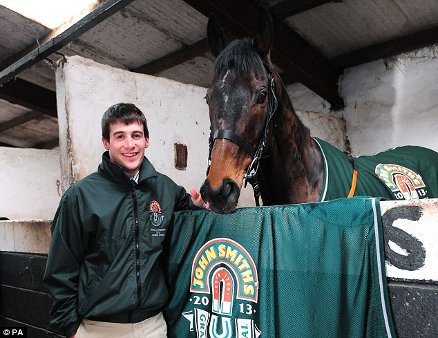 Pre-accident picture: Mania with his Grand National winning horse Auroras Encore yesterday morning just hours before his fall