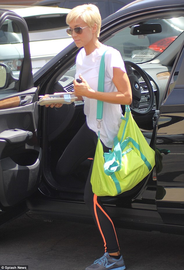 Bright bag: Kellie Pickler totes around a bright green neon bag and holds her lunch on Sunday as she arrives for Dancing With The Stars rehearsals