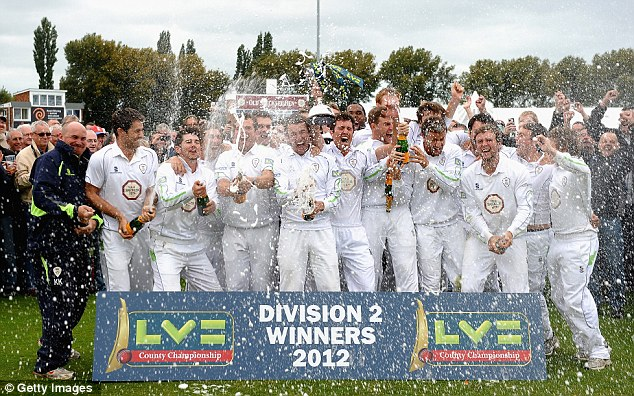 Top dogs: Derbyshire celebrate winning last season's Division Two title