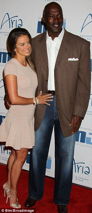Sports stars: Man of the hour Michael Jordan attended the event with fiance Yvette Prieto, while Michael Phelps posed for pictures with another guest