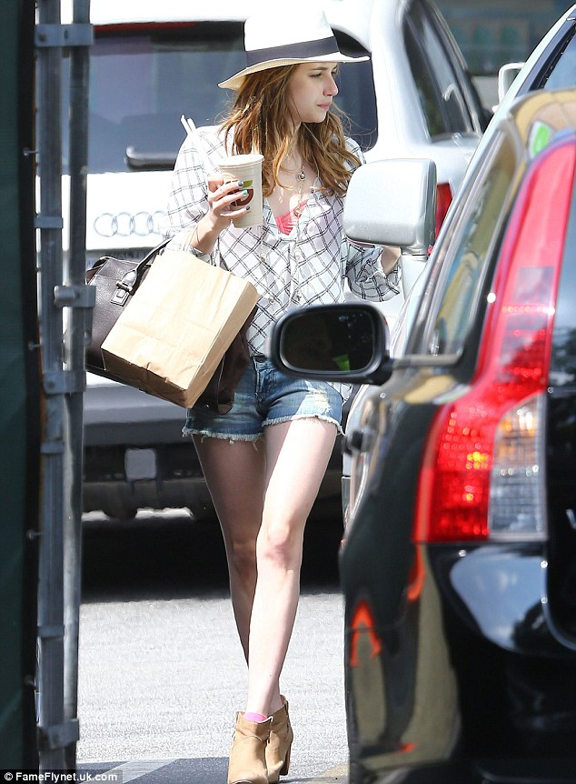 Here comes summer: the Hollywood starlet made the most of the Californian sun as she ran some errands