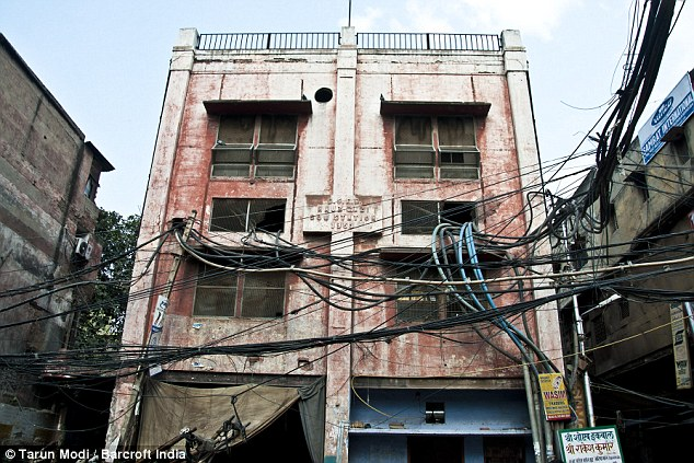 Power supply: A building in Old Delhi is scarred by the tens of cables outside which cross it to the next building