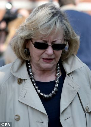 Kent Crime Commissioner Ann Barnes heads for media interviews outside Maidstone Police Station