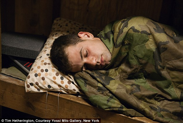 Sleeping like a baby: A solider rests inside a camouflage sleeping bag during a tour of Afghanistan