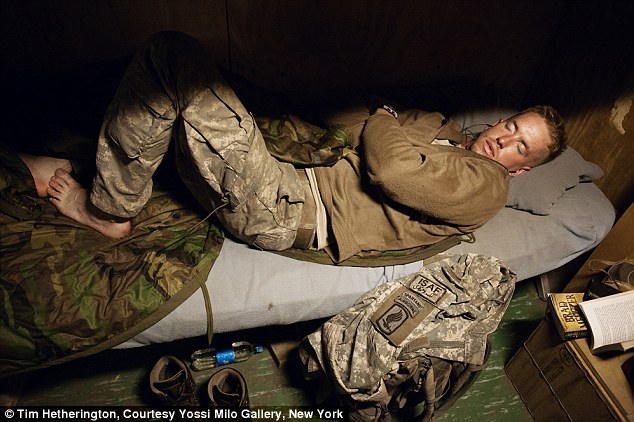 Peaceful moment: A solider, last name Nevalla, takes a well-deserved rest in the Korengal Valley, Kunar Province, Afghanistan in 2008