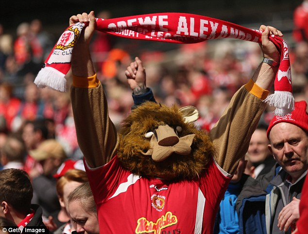 Lion-hearted: A Crewe Alexandra fan enjoys the Wembley atmosphere