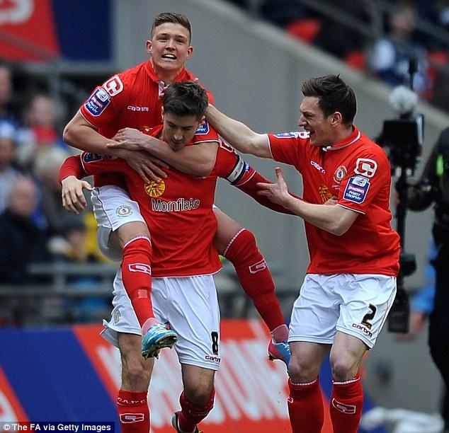 Opener: Luke Murphy (centre) celebrates with Crewe team-mates after breaking the deadlock