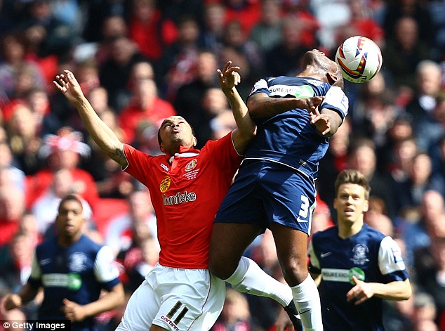 Aerial clash: Southend's Anthony Straker (right) controls the ball from Crewe's Byron Moore