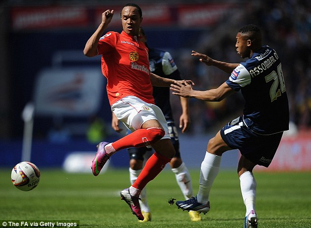 All at stake: Byron Moore battles with Britt Assombalonga of Southend