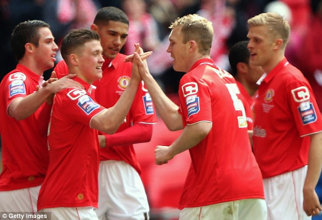 Champions: Crewe players celebrate Max Clayton putting their side 2-0 up at Wembley