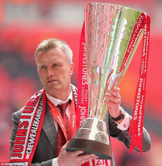 Champion: Crewe Alexandra manager Steve Davis celebrates with the Johnstone's Paint Trophy