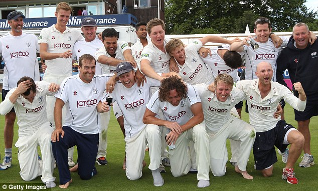 In the up: Yorkshire celebrate last season's promotion from Division Two