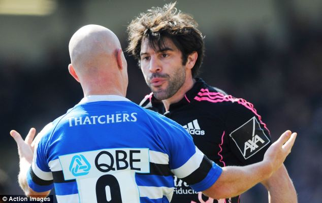 Ban him: Rugby chiefs have urged disciplinarians to ban Jerome Fillol (right) for spitting at Peter Stringer