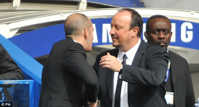 Respect: Rafa Benitez embracing new Sunderland's boss Paolo Di Canio before the game on Sunday