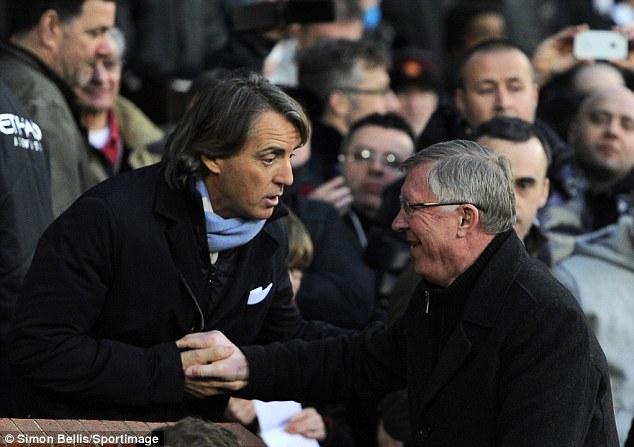 Familiar foes: Mancini and Ferguson shake hands before the game