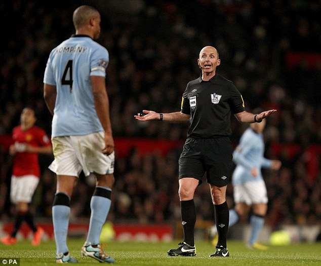 Bad Kompany: Dean booked the City skipper in the first half