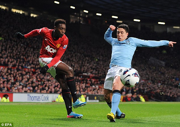 Close encounter: Nasri tries to block Welbeck's cross