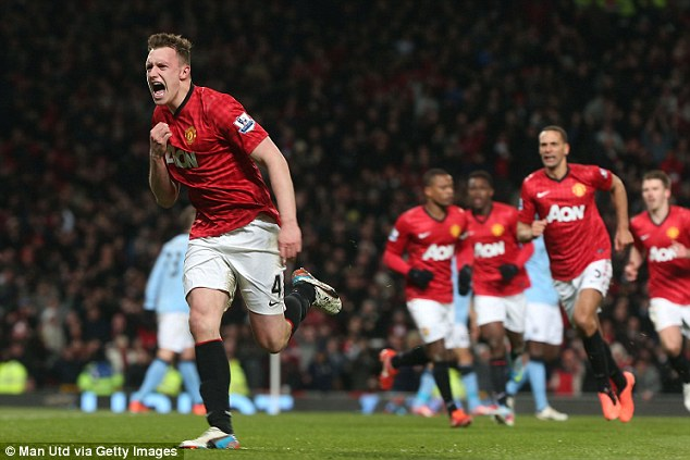 Keeping up with the Jones: The United defender races away to celebrate after Kompany's own goal