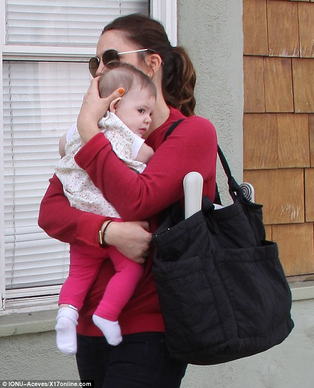 A bag for everything: The Big Miracle star's black tote carried all of Olive's baby essentials most likely including extra diapers and cleaning wipes