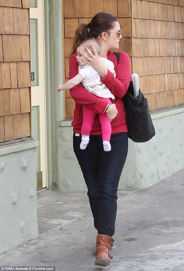 Stylish pair: Drew wore a red knit jumper and Olive looked bright in her comfy pink leggings