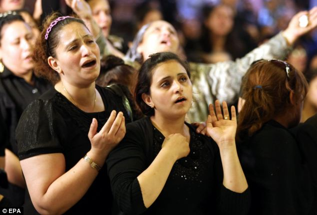 The funerals turned to violence with Copts sheltering inside the cathedral compound after the service