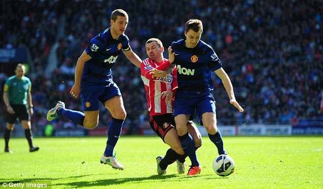 Solid: Nemanja Vidic (left) has stabilised the United defence in the second half of the season