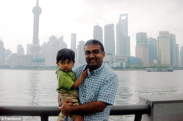 Mr Mahon is seen with his young son in Shanghai. Google offered him the money to ensure he stayed at least three years
