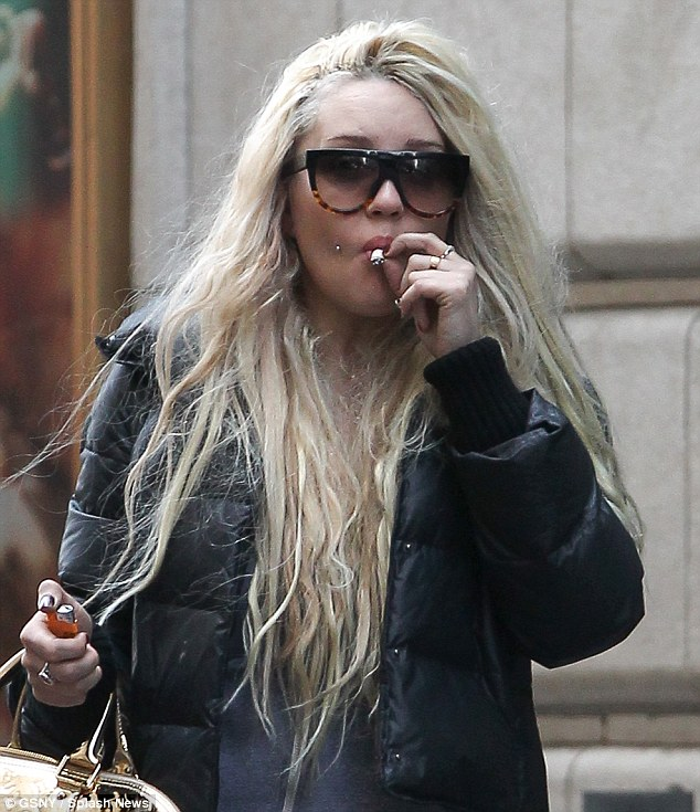 Herbal refreshment? Amanda Bynes continued her bizarre behavior by openly smoking a suspicious-looking hand-rolled cigarette through Times Square on Monday