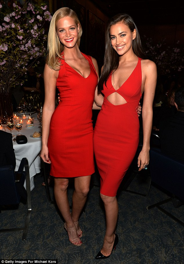 Snap! She joined fellow model Erin Heatherton, who also wore a red dress to the bash