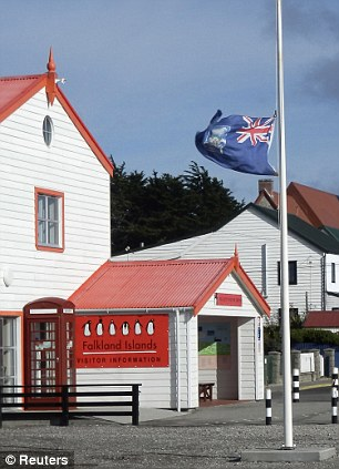The Falkland Islands flag flies at half mast in front of the Visitor Centre after the death of former British prime minister Margaret Thatcher, in Port Stanley