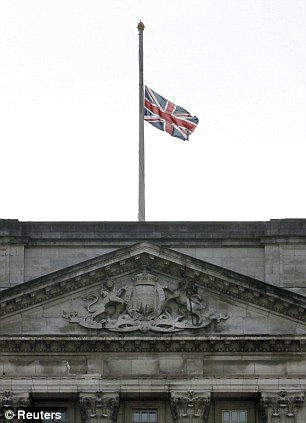 A Union flag flies at half mast over Buckingham Palace after the announcement that Britain's former prime minister Margaret Thatcher died today