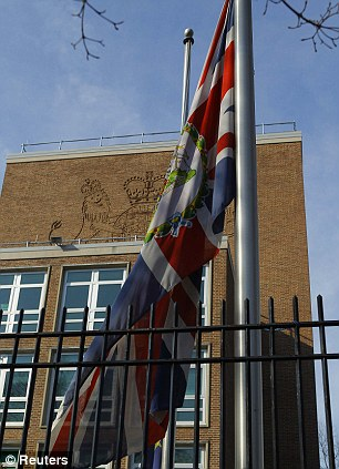 The Union Jack flag is seen at half-mast after the death of former British prime minister Margaret Thatcher, at the British Embassy in Washington April 8