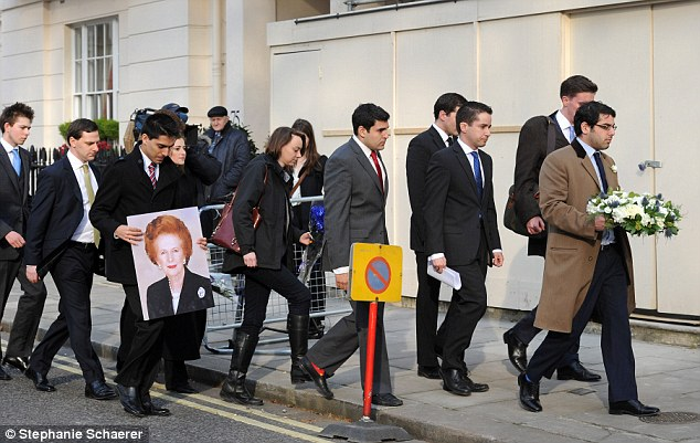 Spontaneous tribute: Carrying bouquets, wreaths and poster pictures, well-wishers arrived at Lady Thatcher's home in Belgravia, central London, within an hour of the news of her death being broadcast