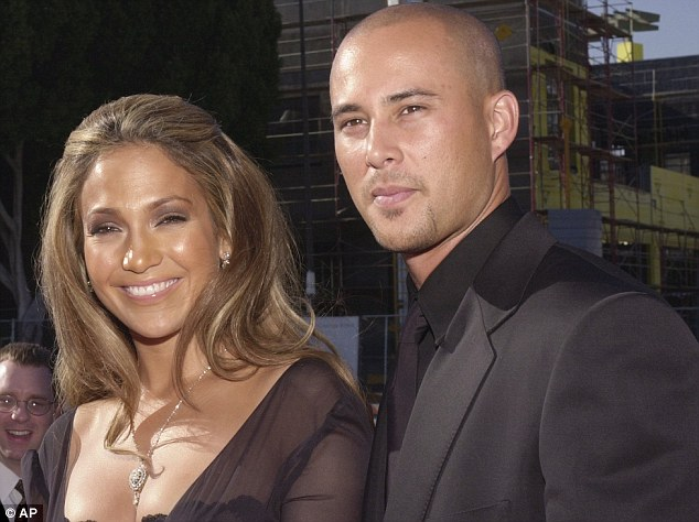 Happier times: Jennifer and Chris in another coordinated look at an awards ceremony in 2001