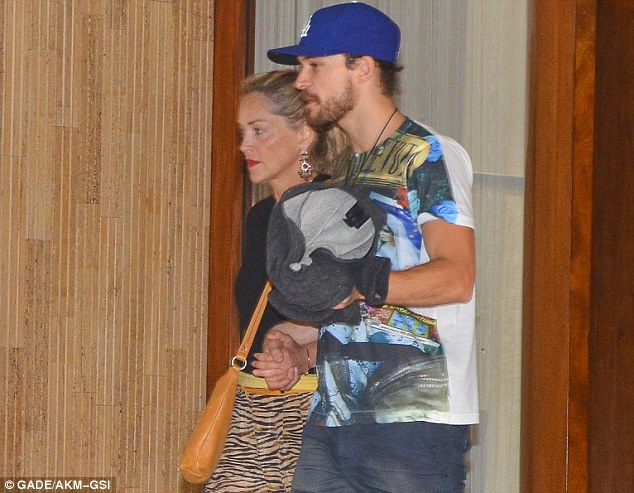Clashing fashions: The Basic Instinct star sported animal print trousers and a black top and sandals for her casual dinner