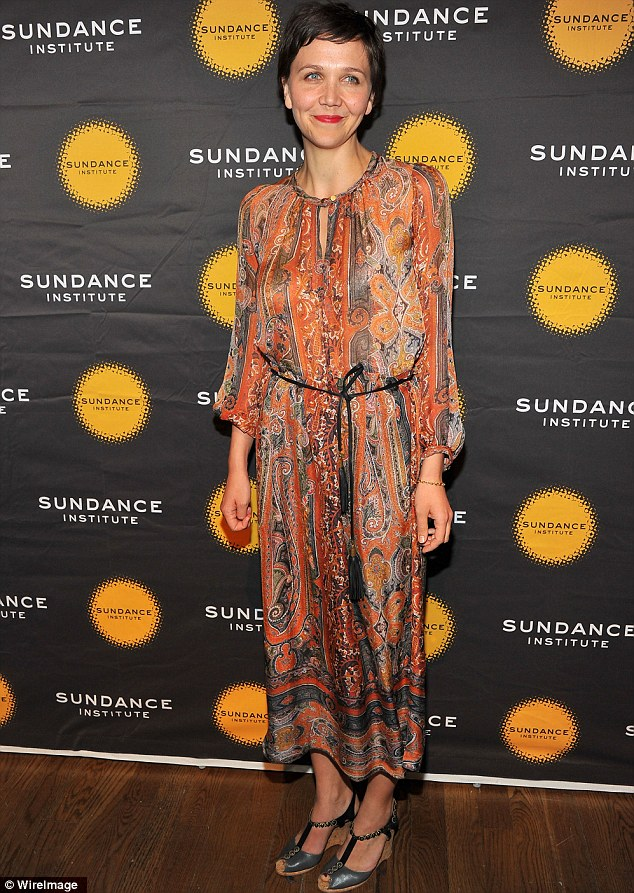 Hippie chic: Maggie Gyllenhaal arrived at the Celebrate Sundance Institute benefit in New York City on Monday night sporting an orange patterned paisley print dress