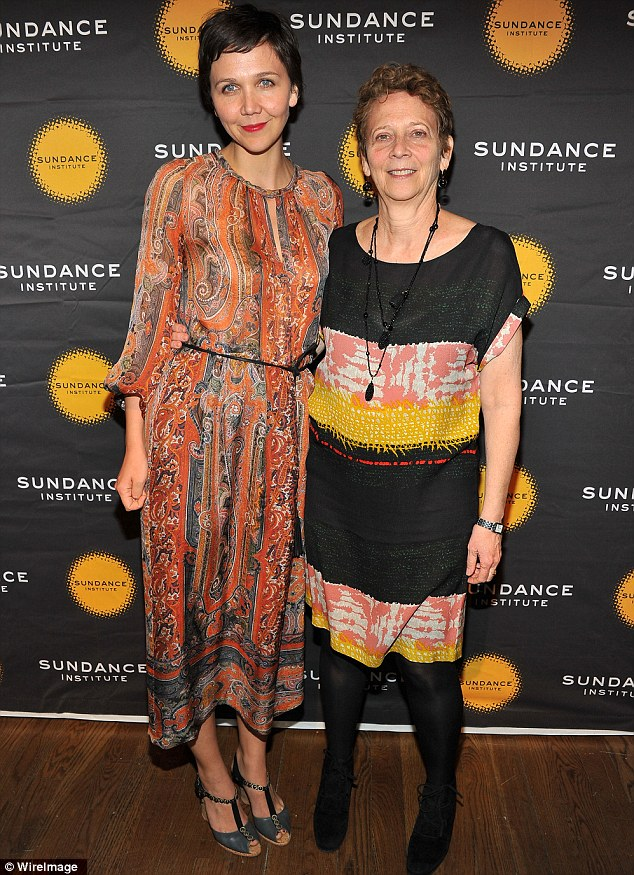 Like mother, like daughter: The actress was joined by her screenwriter mother Naomi Foner Gyllenhaal who sported a black dress with coloured panels on the carpet