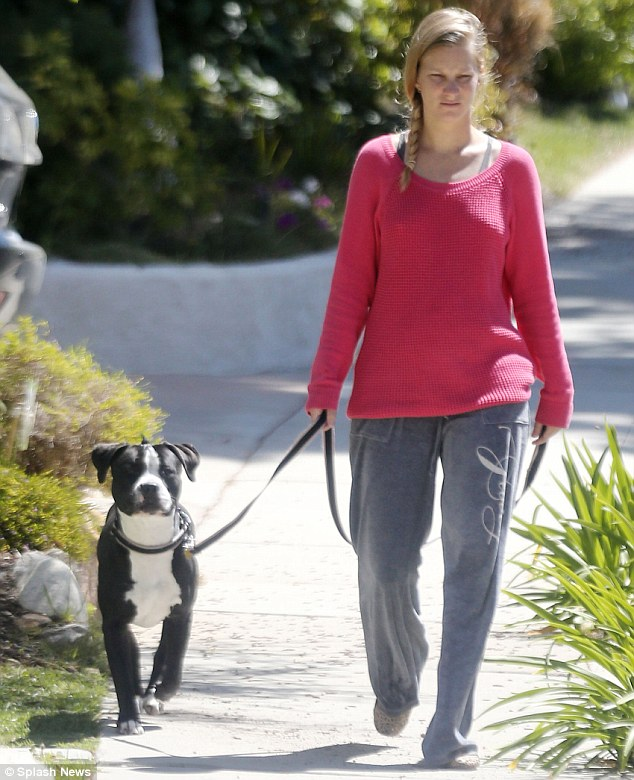 Walking the dog: Glee star Heather Morris kept her baby bump under a baggy sweatshirt Saturday while out near her Los Angeles home.