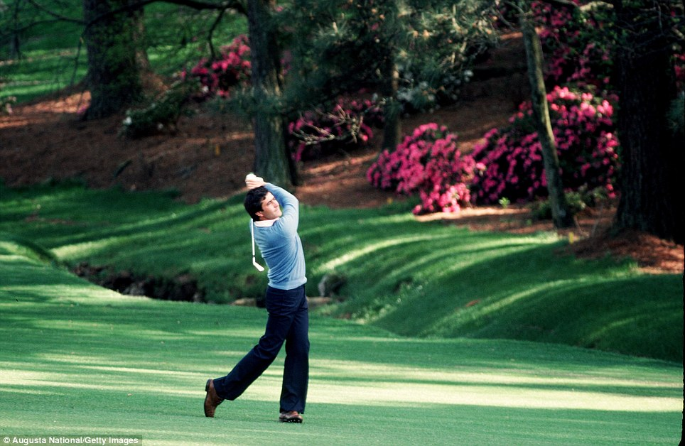 Seve Ballesteros hits over the water on the 13th hole during the 1983 Masters