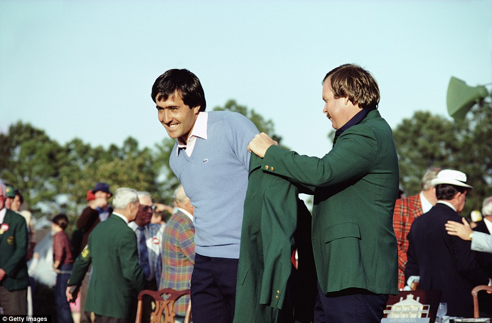 Seve Ballesteros is helped into the green jacket by Craig Stadler after his victory in 1983