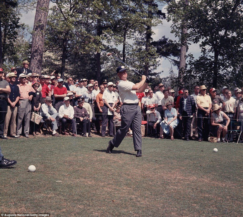 Jack Nicklaus watches his tee shot in front of a small gallery during the 1963 Masters