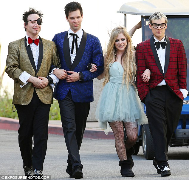 Me and the boys! The 5ft1 songstress strutted down the street looped arm-in-arm with her bandmates