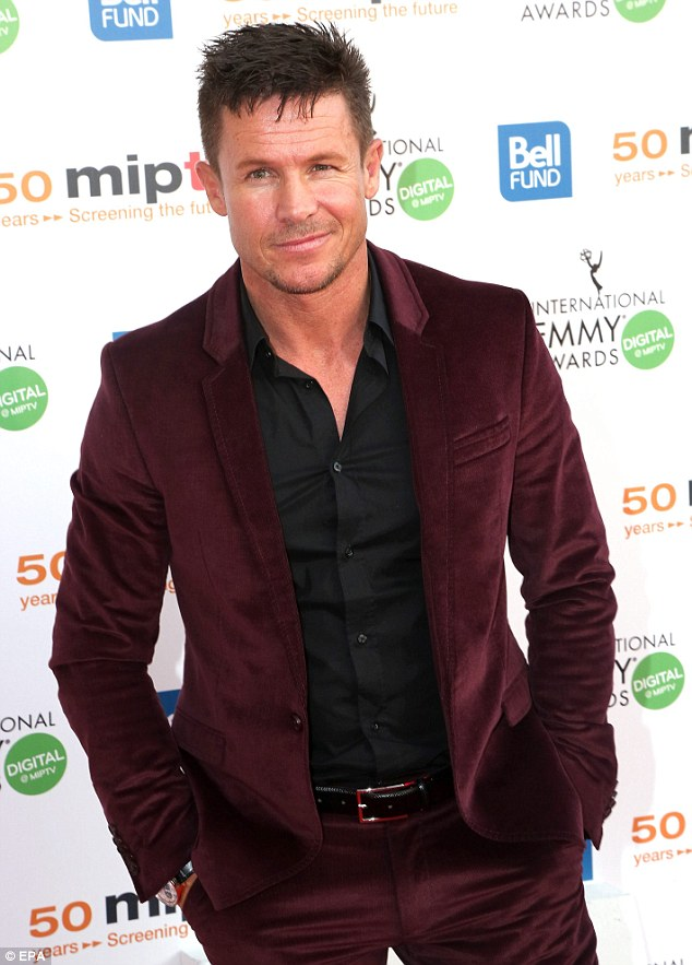 Suited and booted: Austrian skydiver Felix Baumgartner wore a maroon coloured suit with a black shirt to mingle inside