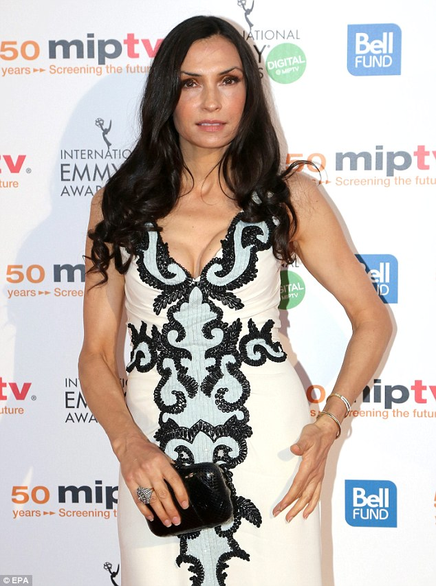 Glammed up: Dutch actress Famke Janssen also arrived for the MIPTV 50th Anniversary Opening Gala at the Festival Palace in a pretty dress