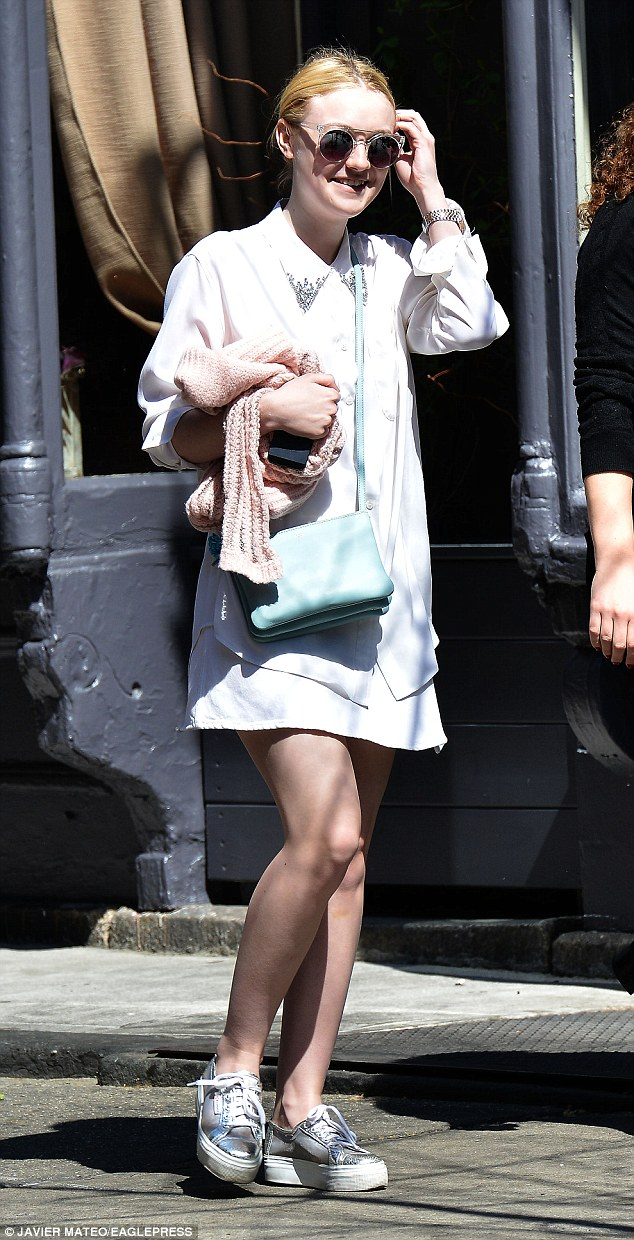Beaming: Dakota Fanning happily savored the New York City weather during a walk home from lunch in the city's downtown NoLIta neighborhood Monday morning