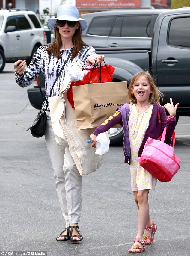 Tongue-in-cheek: Jennifer Garner guided her smiling daughter Violet to the family car in Brentwood, California, on Monday