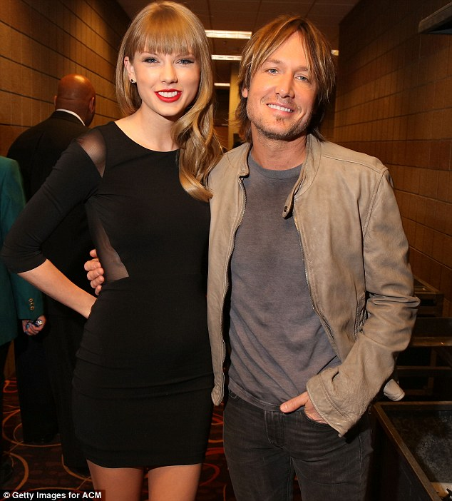 Rubbing shoulders: Keith Urban and Taylor looked happy and relaxed following their performance backstage